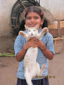 A village girl posing with her cat :)