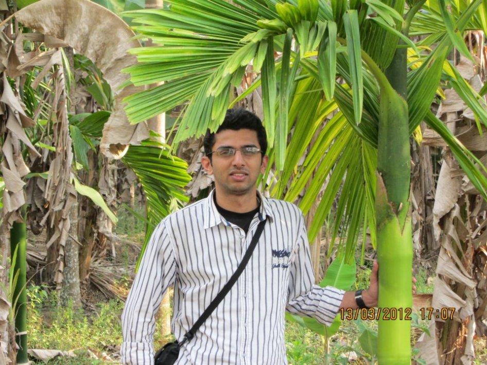 Posing with areca palm..